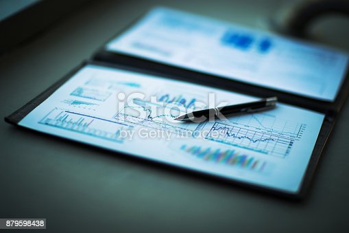 istock Drawings and charts of successful business, workplace of the businessman 879598438