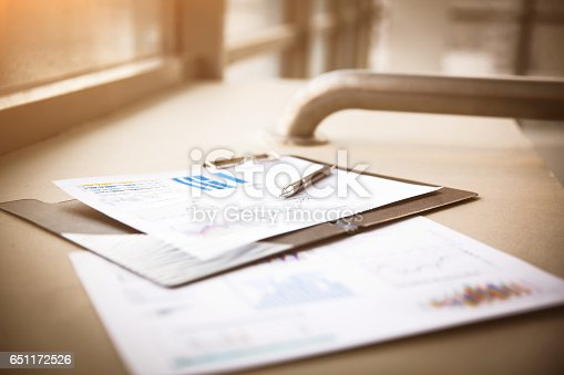 istock Drawings diagrams and charts of successful business, workplace  a businessman in  modern offi 651172526