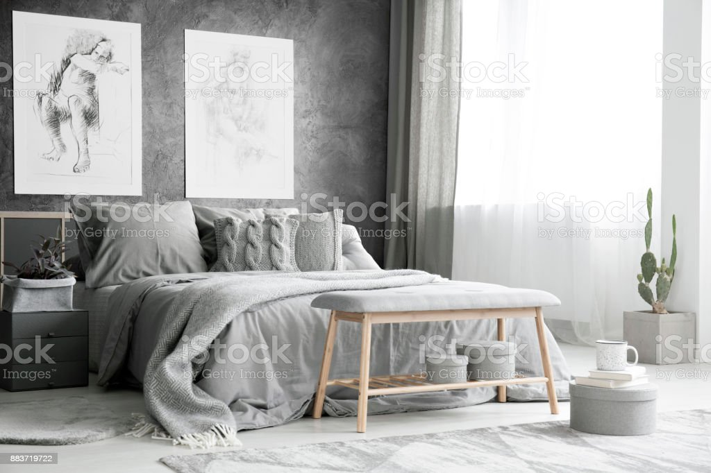 Drawings in bright grey bedroom stock photo