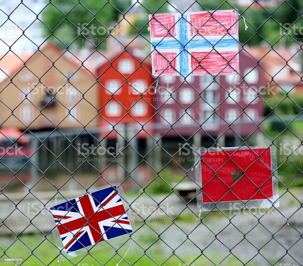 drawings of flags on the fence royalty-free stock photo