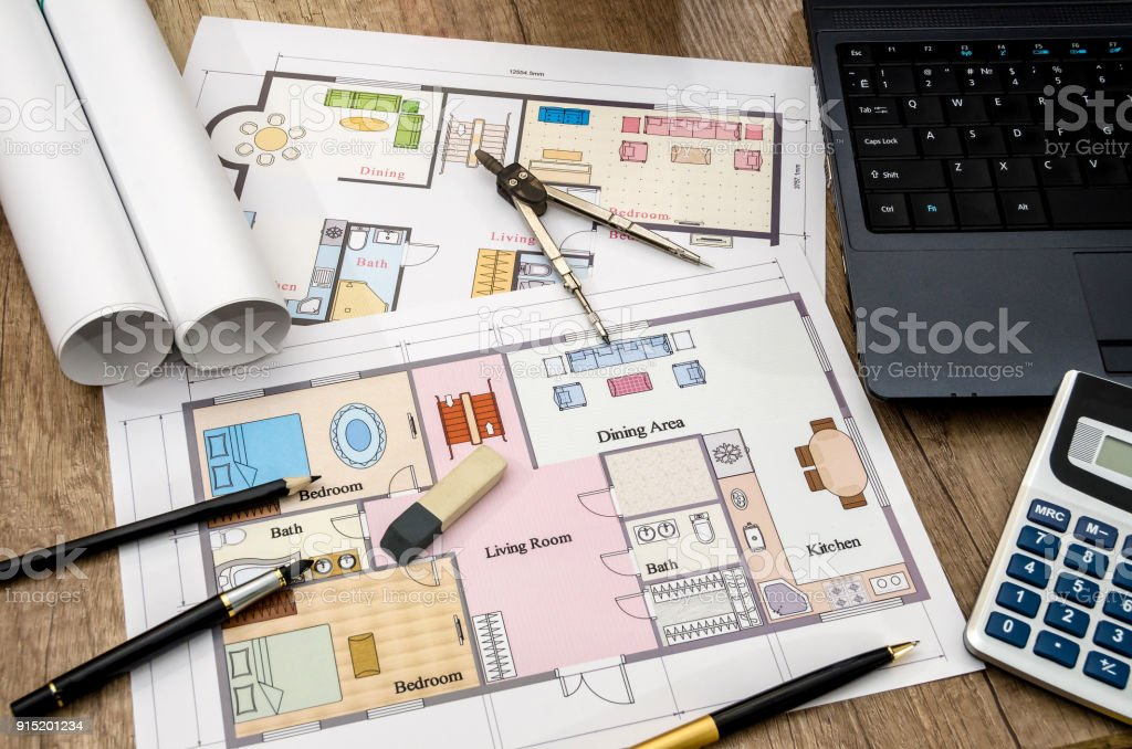 drawings on paper with a laptop and a calculator stock photo