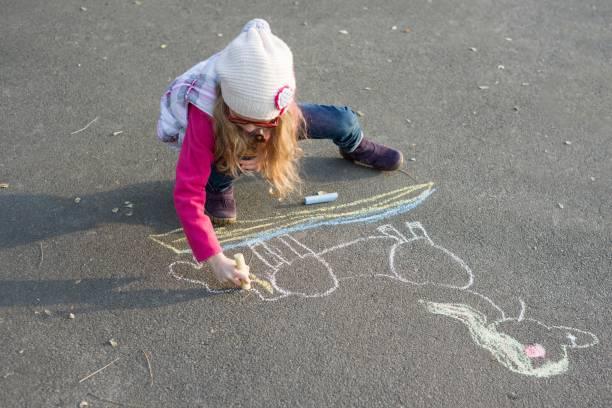 Drawings on the sidewalk girl child draws a unicorn picture id1025899264?b=1&k=6&m=1025899264&s=612x612&w=0&h=kv7gboeikvmfswwvpwmm3w7oyysz2gm05ad2bxvvb y=