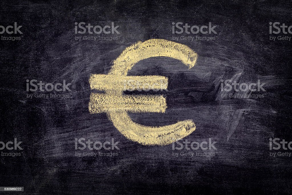 Drawn euro sign on black chalkboard background stock photo