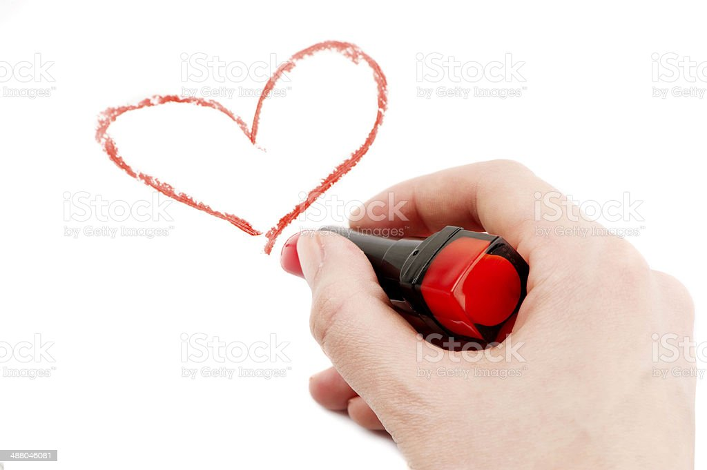 Drawn heart in lipstick stock photo