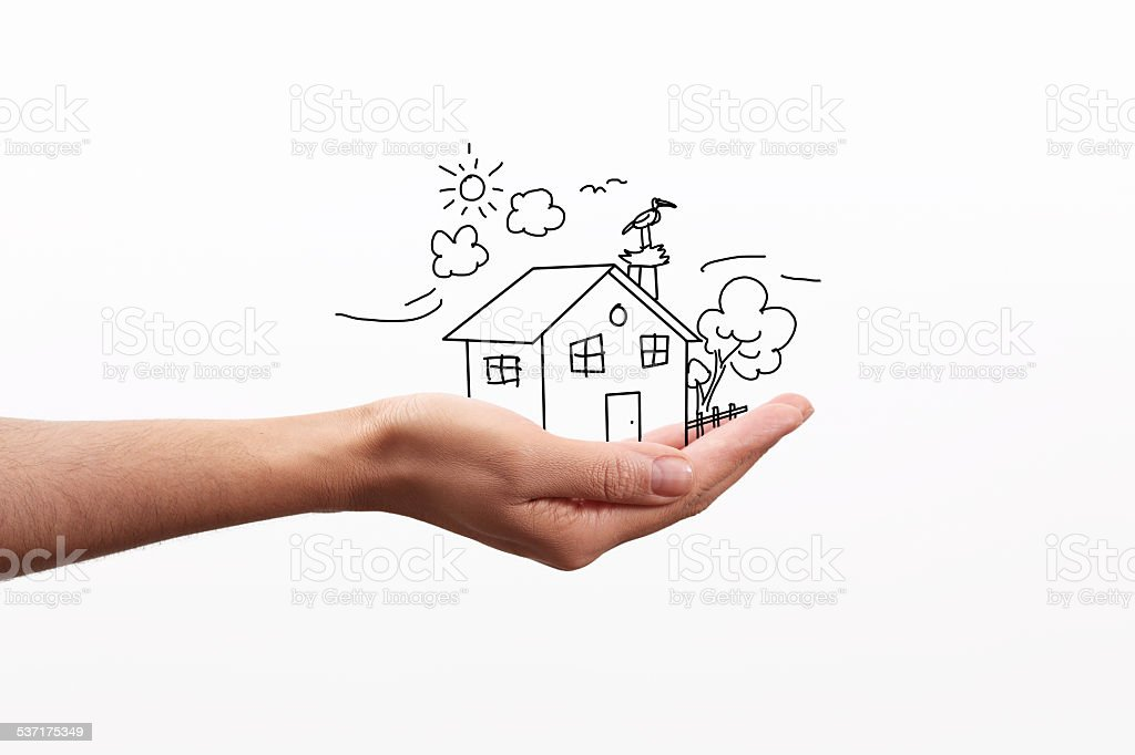 drawn house on palm stock photo