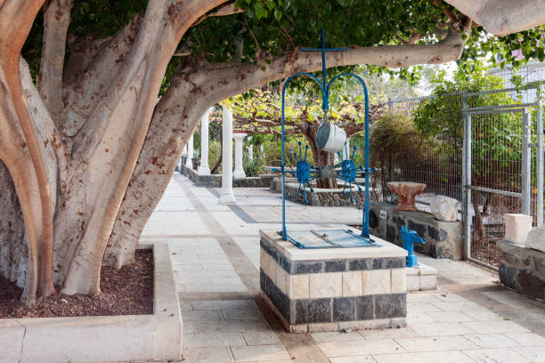 Draw-well in courtyard Greek Orthodox monastery of twelve apostles stock photo