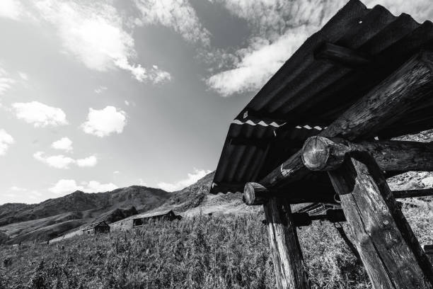 draw-well in mountains, greyscale shooting - altai nature reserve стоковые фото и изображения