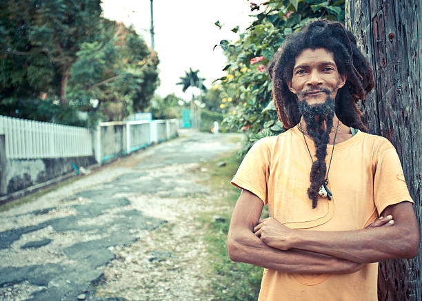 dreadlock portrait smiling rastaman posing in the street. rastafarian stock pictures, royalty-free photos & images