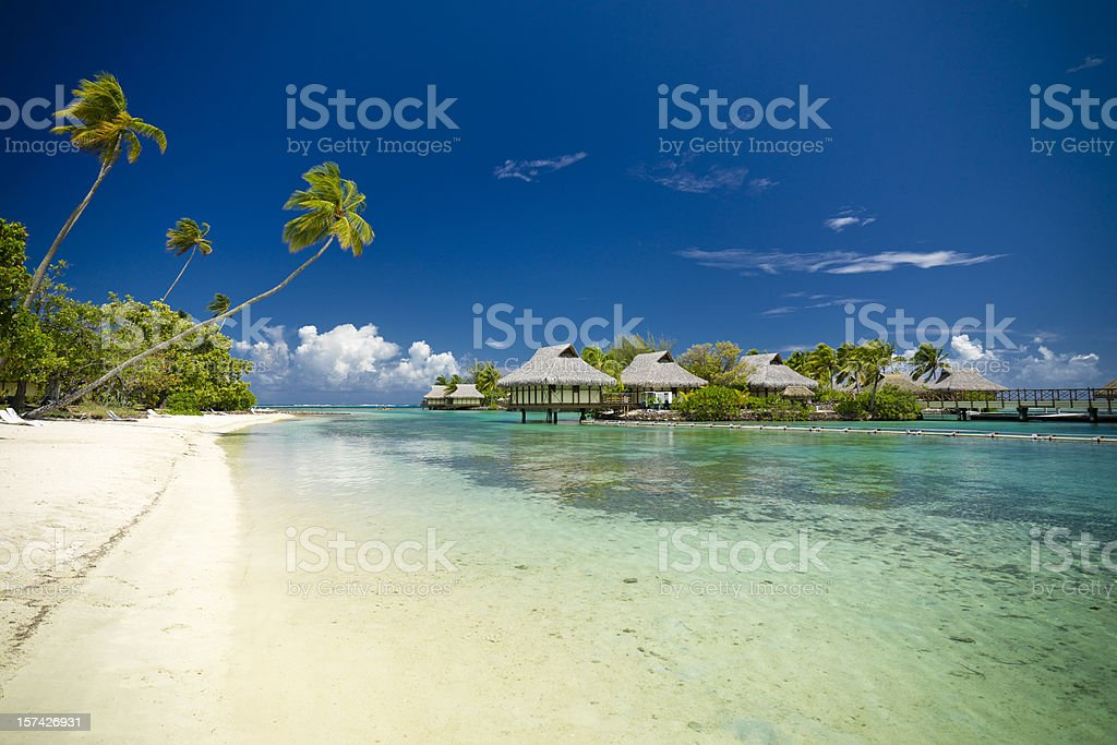 Dream Beach Vacation Hotel Cottages in Lagoon stock photo