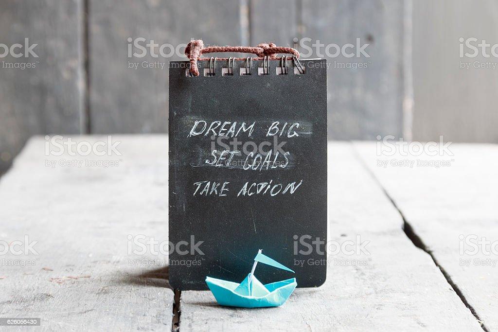 Dream big, set goals, take action on blackboard written, start stock photo