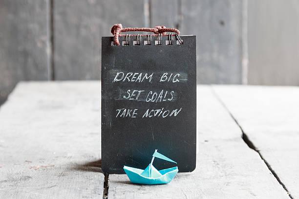 dream big, set goals, take action on blackboard written, start - traum team stock-fotos und bilder