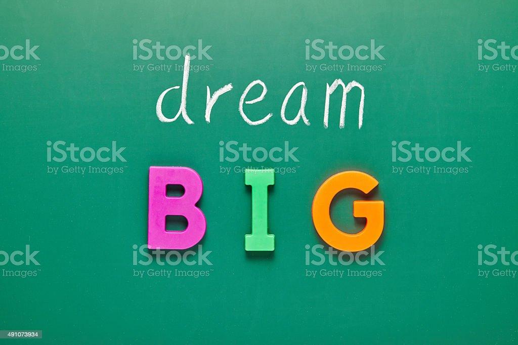 dream big, words on blackboard stock photo
