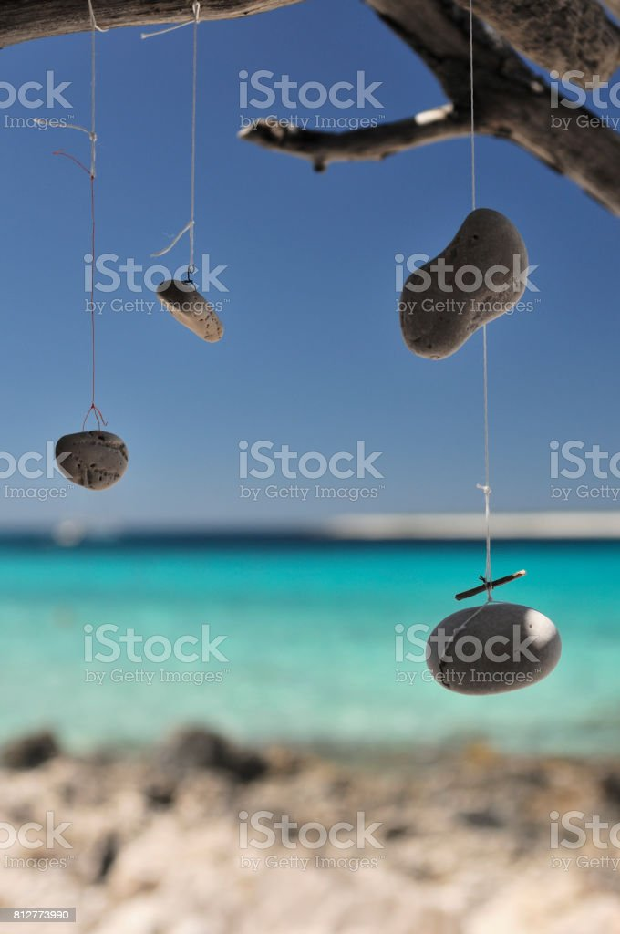 Dream catcher and wind chime by the sea stock photo
