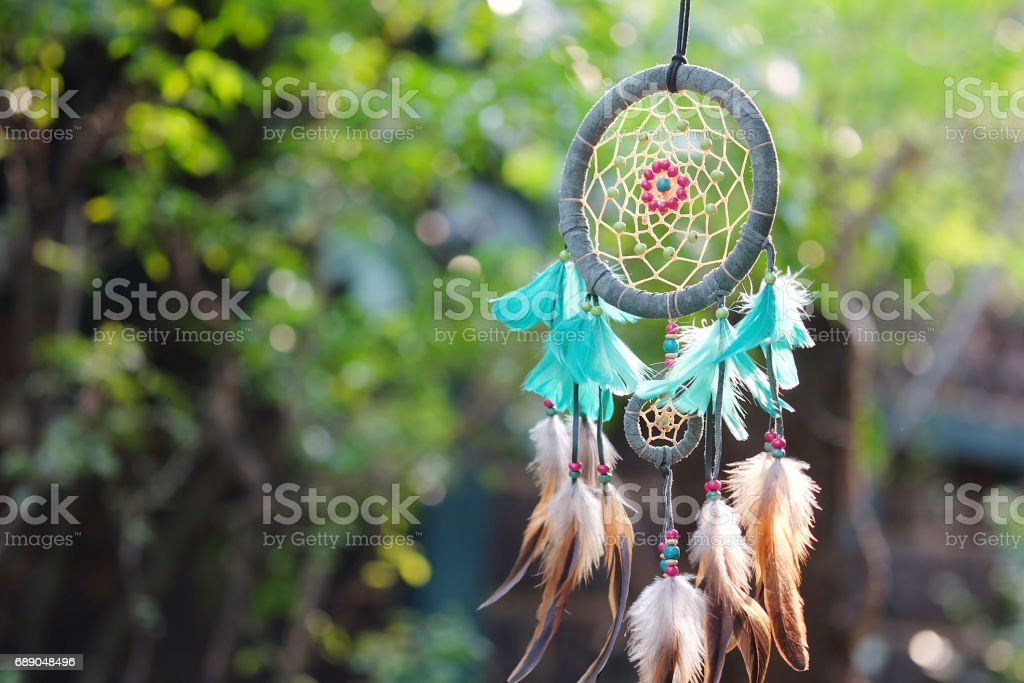 Dream Catcher Blue Coral with natural background in vintage style. boho chic, ethnic amulet. stock photo