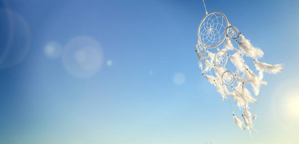 Dream catcher on blue sky background with copy space stock photo