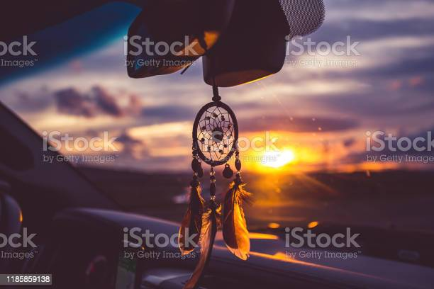 Dream catcher on car over blurred highway background picture id1185859138?b=1&k=6&m=1185859138&s=612x612&h=31utvgx0bbqn4gk qbv2ergckesxnibzmzwemo5v97q=