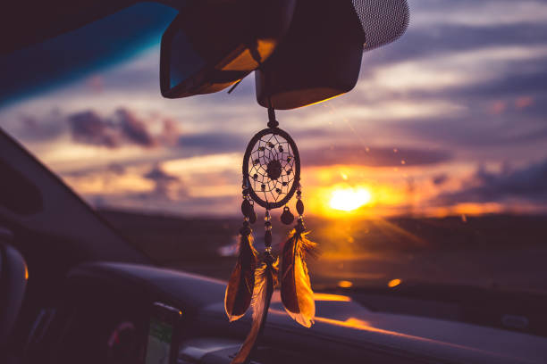 dream catcher on car over blurred highway background. stock photo