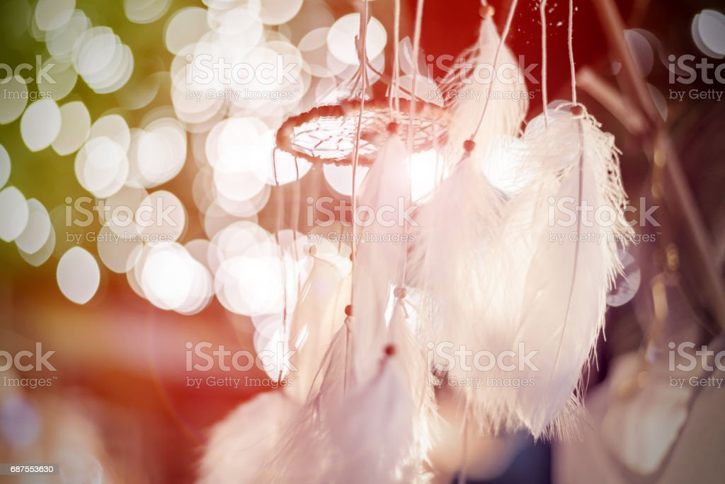 dream catcher with bokeh lights background at night - Photo