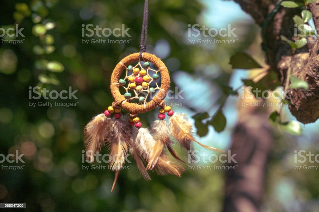 Dream catcher with natural background. boho chic, ethnic amulet. stock photo