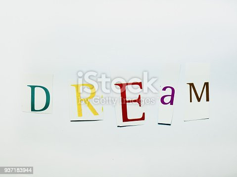 474062446istockphoto Dream - Cutout Words Collage Of Mixed Magazine Letters with White Background 937183944