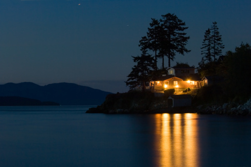 Lighted house on Pacific coast, Washington state