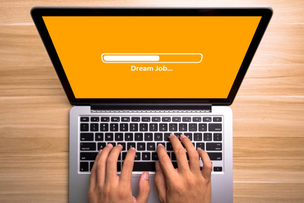 Dream Job Concept Laptop Screen With Typing Hands On Keyboard stock photo