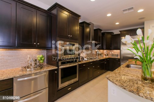 Kitchen with modern appliances and granite countertops.