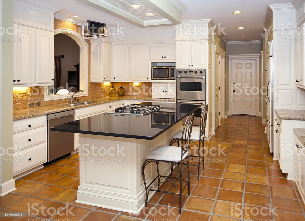 Dream kitchen with marble counter tops custom lighting tile floors stock photo more pictures - Encimeras de azulejos ...