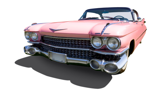 A pink American automobile, the icon of 1950's elegance, is isolated against a white background with shadow and includes clipping path.