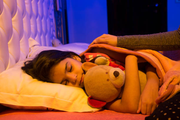Dream - Stock image Sleeping, Child, Bedtime, Bed - Furniture, Girls teddy bear stock pictures, royalty-free photos & images