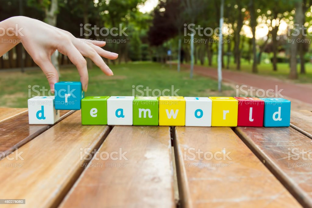 Dream World, word and hand stock photo