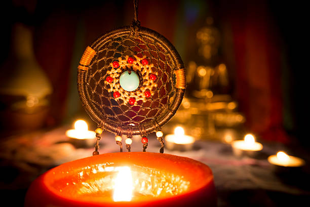 dreamcatcher and candle light. - traumfänger malerei stock-fotos und bilder