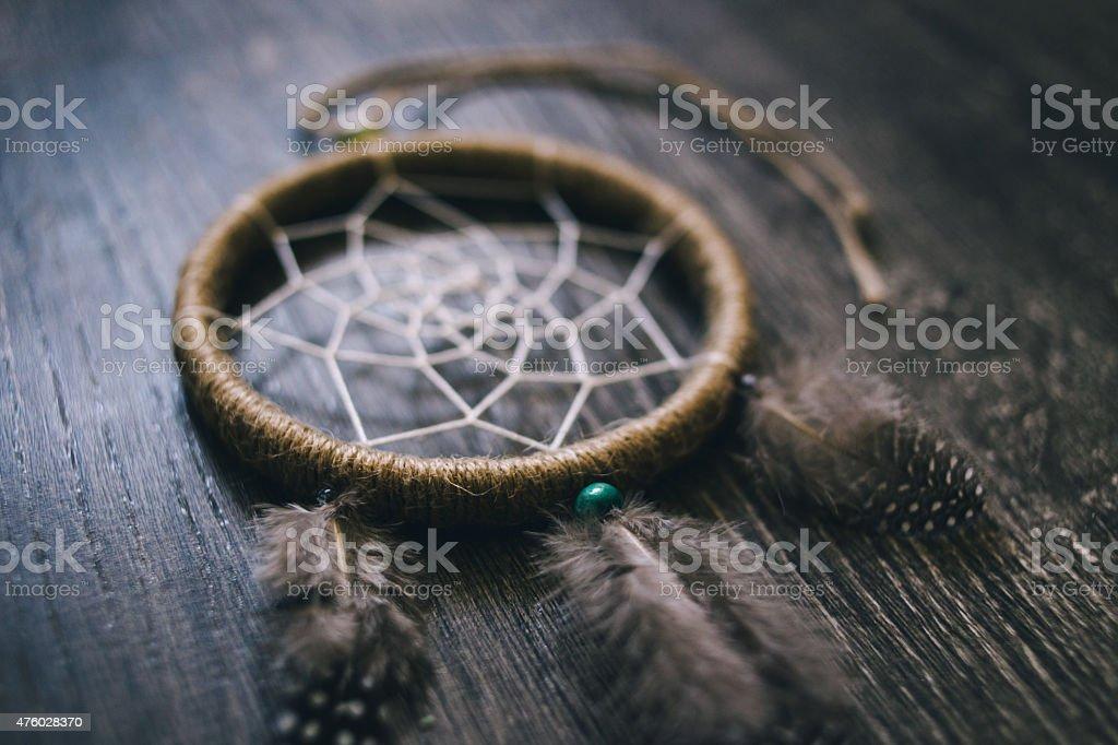 Dreamcatcher on the dark wooden surface stock photo