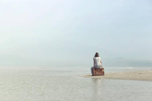 dreamer woman relaxing in a surreal atmosphere - donna valigia solitudine foto e immagini stock