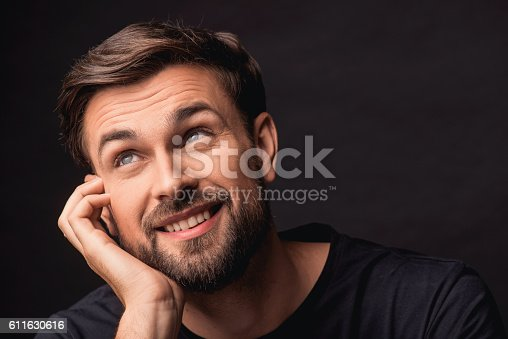 611630440 istock photo Dreamful guy expressing positive emotions 611630616
