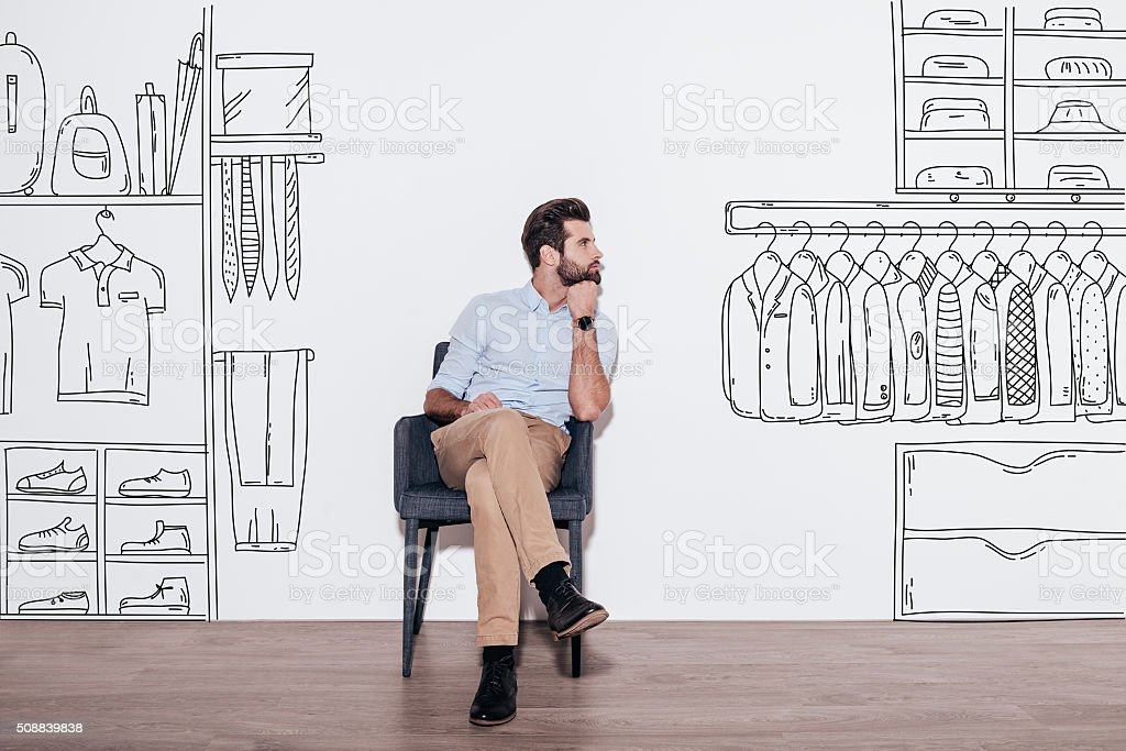 Dreaming about new wardrobe. stock photo