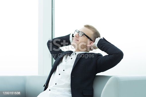 530281733istockphoto dreaming businessman sitting in the office lobby 1200151538