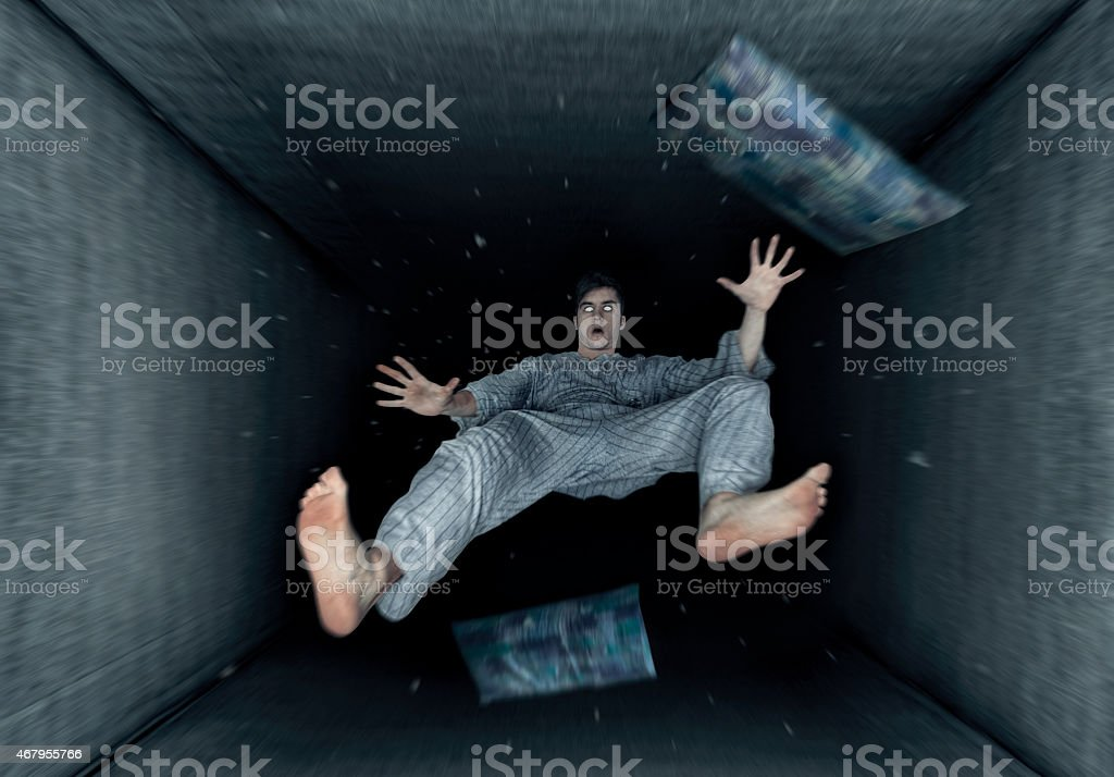 dreaming guy with the sensation of falling stock photo