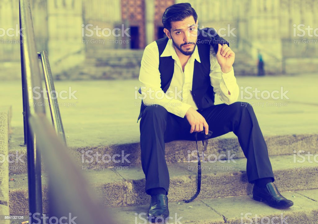 Dreaming man sitting on stone steps royalty-free stock photo