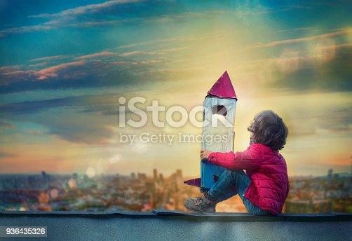 Boy Holding a Cardboard Spaceship