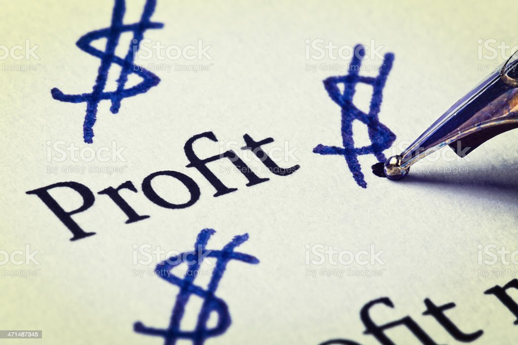 Dreaming of success, pen doodles dollar signs next to Profit royalty-free stock photo