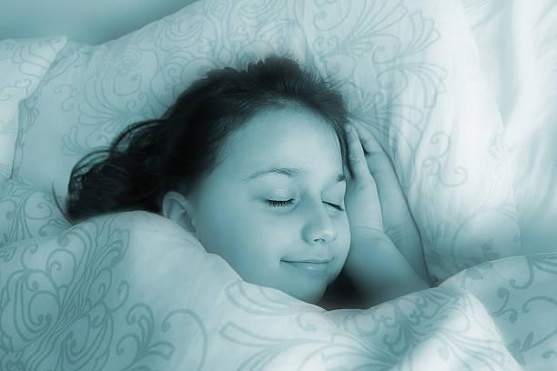 Dreaming pretty little girl. stock photo