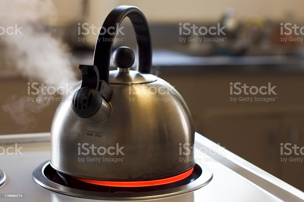 Dreaming tea kettle on the stove stock photo