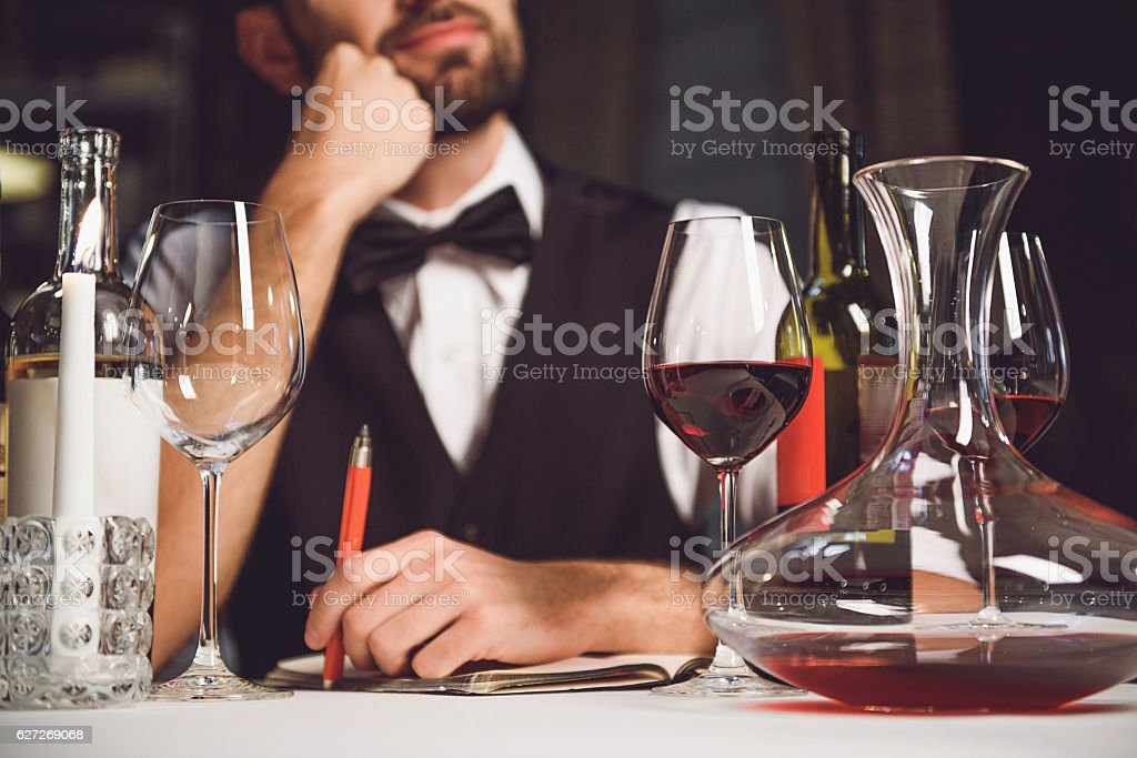 Dreaming wine critic looking up stock photo