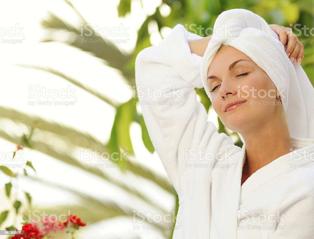 Dreaming young woman after bath royalty-free stock photo