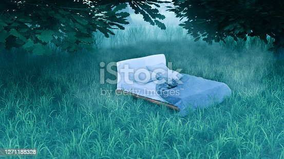 Bed stands in the forest surrounded by grass and trees. Fairty tale looking scene.