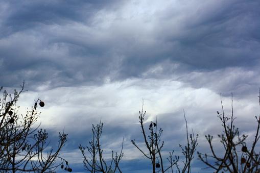 Dreamlike Sky dark clouds: Dramatic sad storm cloudscape, winter landscape