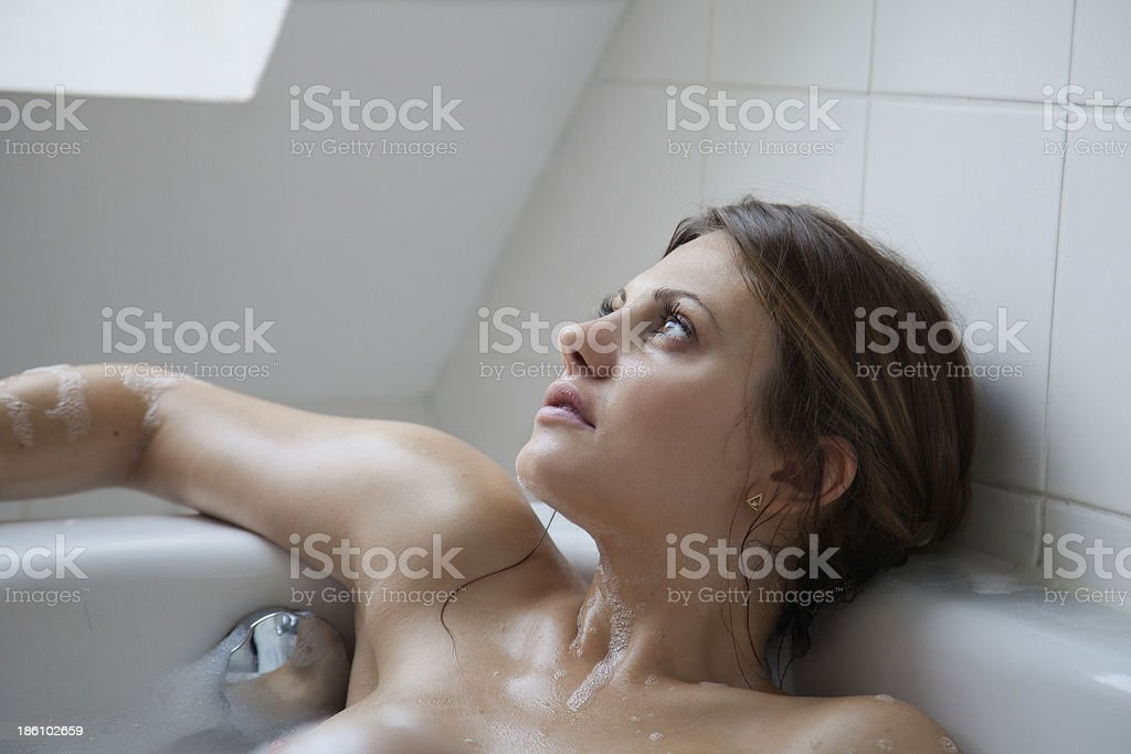 Dreams And Girl In The Bathtub Royalty Free Stock Photo