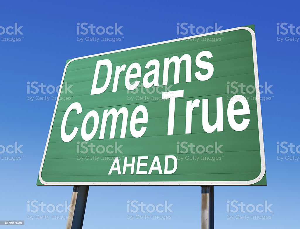 Dreams Come True Ahead Highway Sign stock photo