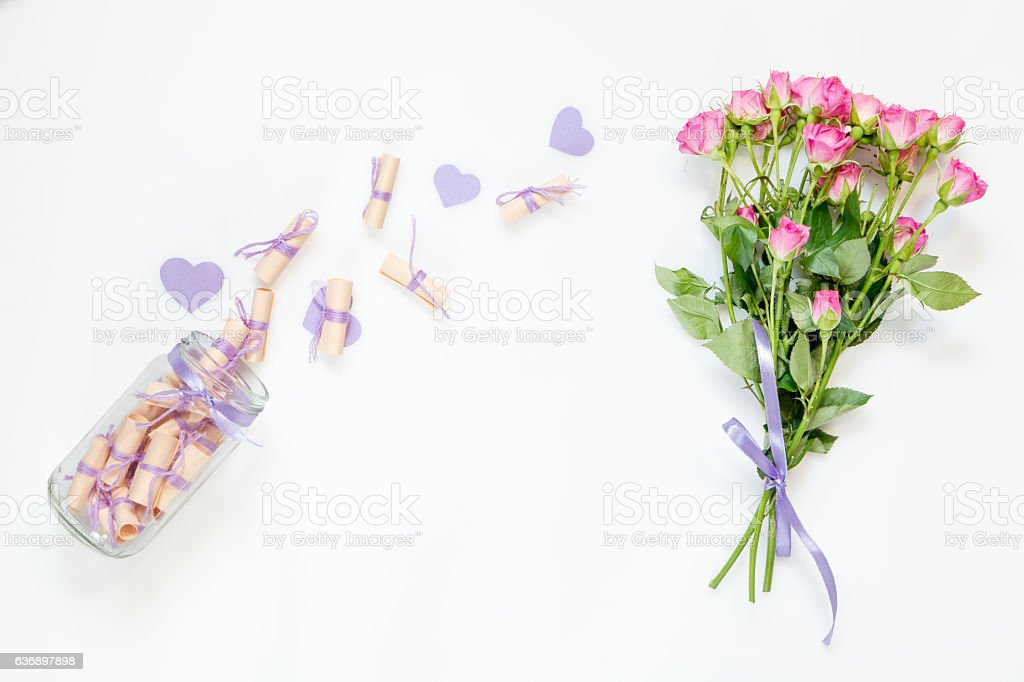 Dreams on a rolled paper and pink little roses stock photo